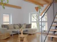 Gruppenferienhäuser und Ferienhütten in Bayern - Bild vom Wohnzimmer